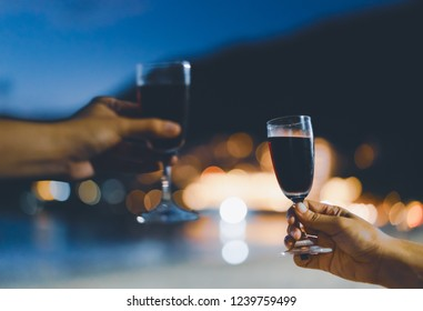 one focus wine glass waiting for blurred one to celebrate moment, light bokeh as background, vintage tone