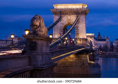 One of the four lion statues on the end of Chain Bridge in Budapest.
