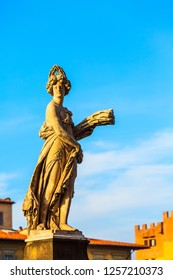 One of Four seasons, Summer statue at Ponte Santa Trinita bridge over Arno river in Florence, Italy