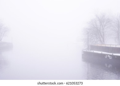 One frame of a series of images produced to emphasize the emotional and dramatic effects of the mist setting on the river bed in a local town during the seasonal changes into the early springtime.