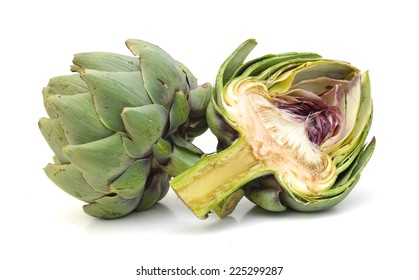 One fresh artichokes with stem and leaf and a half showing the heart. Isolated.