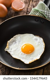 One fresh fried egg sunny side up in skillet (Selective Focus, Focus on the front of the egg yolk)