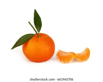 One fresh whole mandarin orange with green leaves and separate group of three wedges segments isolated on white, close up, low angle side view