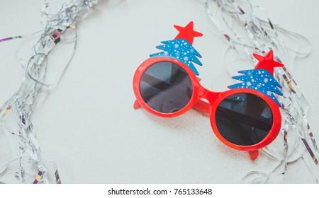 one funny glasses Celebrating new year, xmas party. funny style background on white