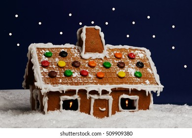 One ginger bread house in a winter landscape.