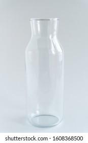 One glass bottle stand at gray backround. Zero waste storage. Minimalist lifestyle. Copy space.