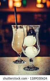 one glass with ice cream and one glass with coktail