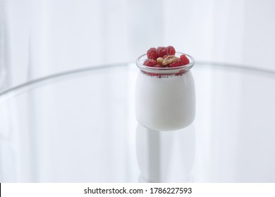 One glass jars with fresh homemade organic yogurt decorated with fresh berries and nut, white glass background copy space. - Shutterstock ID 1786227593