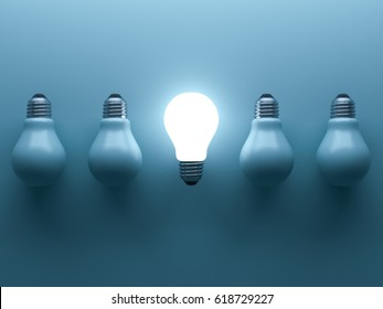 One glowing light bulb standing out from the unlit incandescent bulbs on cyan background with reflection and shadow , individuality and different creative idea concepts . 3D rendering.