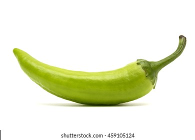 One green hot peppers on a white background, isolated