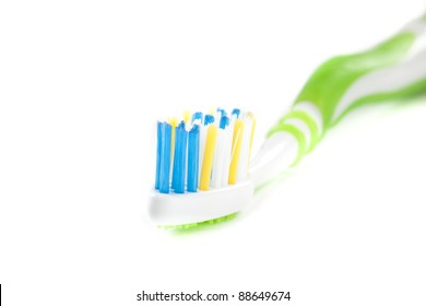 One Green Toothbrush on White Isolated Background