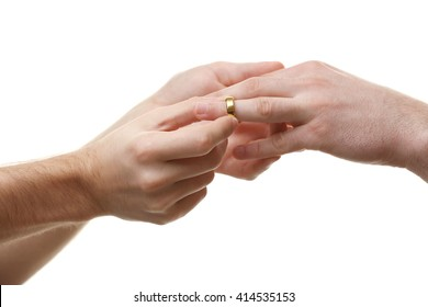One groom putting a wedding ring on another man's finger isolated on white