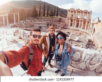 One group of traveler friends having fun in a sunny winter day in Ephesus/Efes Izmir Turkey