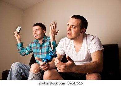 One guy loses to another while playing a video game