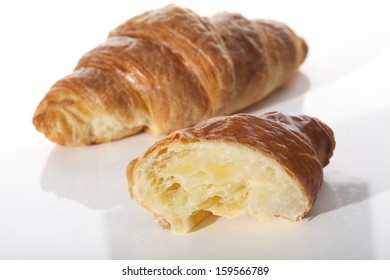 One and a half of croissant on white isolated background