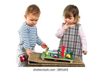 One and a half year old children: a boy and a girl are playing together.