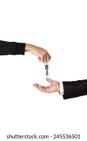 One hand handing over keys to another hand isolated on a white background.