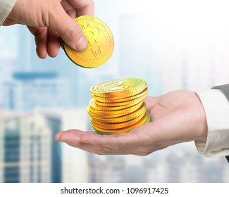 One hand picking golden digital coin of question mark from another hand. Concept of cryptocurrency, blockchain technology, bitcoin mining, electronic virtual money.