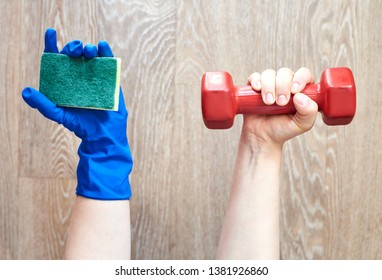 One hand of a woman with dumbbells, the other hand in a rubber glove with a sponge for cleaning. The choice between sports and homework for housewives.