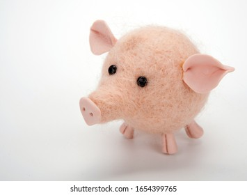 one handmade artificial pink pig toy on a white close up