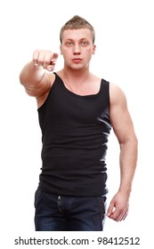 One handsome Caucasian muscular man pointing in black t-shirt isolated on white background.