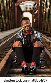 One happy african american male posing for high school senior portraits