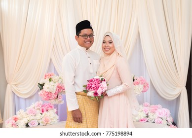 one happy newly wed Malay couple pose  during Malay wedding ceremony.