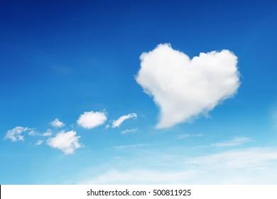 it is one heart shaped cloud on blue sky.