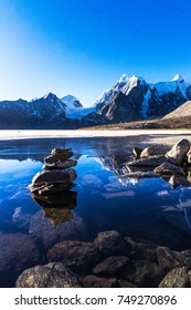 One of the highest glacier lake which can be reached by a nicely paved road is Gurudongmar, semi frozen at the time and situated in the upper reaches of Sikkim, captured in the wonderful morning light