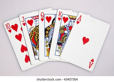 One of the highest hands in poker a heart Royal Flush isolated on white.