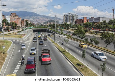 One of the highways or main roads in the city of Medellin, Colombia. Heavy traffic with different cars in Medellin, city in south america.