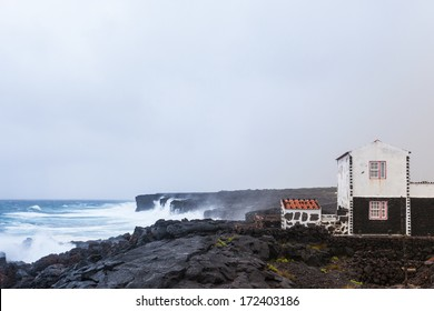One house against storm on the cliffs of Pico island, Azores islands. Symbolizing the loneliness.