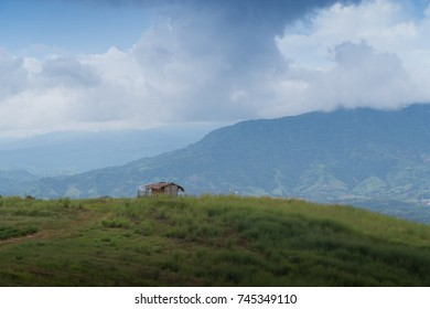 One house on green field mountain with copy space.