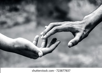 One human hand helping another hand to overcome his fear.