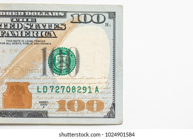 One hundred 100 dollar bill shot against a white background