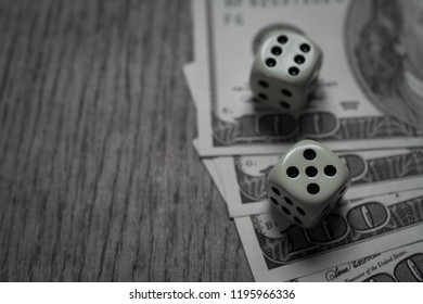 one hundred banknote with two game dice with copyspace