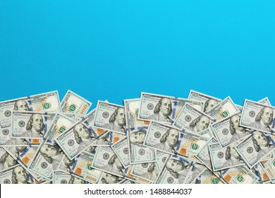One hundred dollar banknotes on colored background top view, with empty place for your text business money concept. One hundred dollar background..