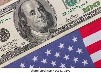 One hundred dollar bill with an American flag