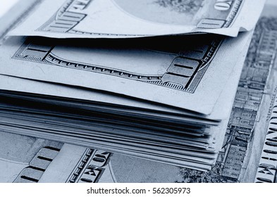 A lot of one hundred of dollar bills.