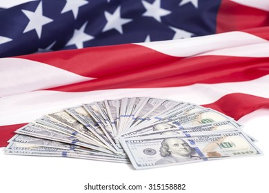 One hundred dollar bills with American flag isolated