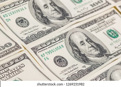 Lot of one hundred dollar bills close up background