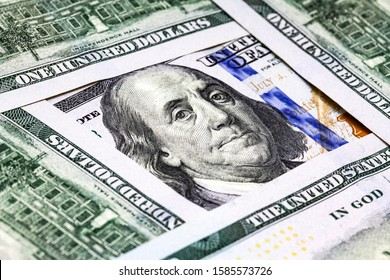 One hundred dollar bills close up. background of 100 dollar bills. Benjamin Franklin's look on a hundred dollar bill. Benjamin Franklin portrait macro usa dollar banknote or bill. Top view banknotes.