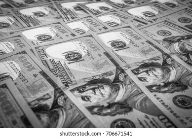 One hundred dollar bills close up in black and white