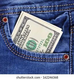 One hundred dollar bills in jeans pocket