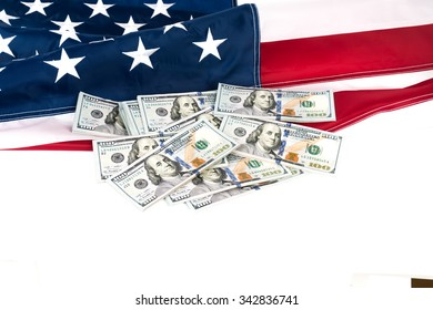 One hundred dollars banknotes on flag background