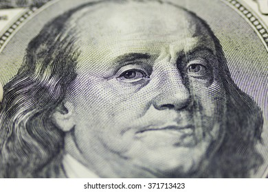 One hundred dollars close up as background