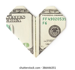 One hundred dollars folded into heart isolated on white background. Love money concept.