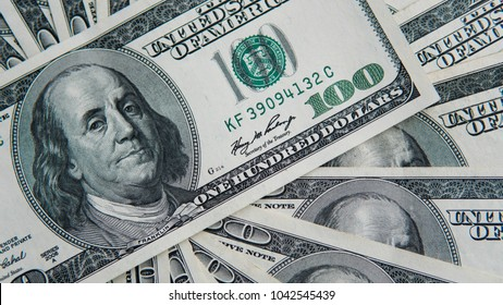One hundred dollars pile. Money background, heap of dollars, financial concept of earnings. Top view. Financial, bussiness, commercial and banking concept. American dollars in one hundred banknotes.