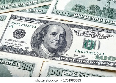One hundred dollars. Portrait of President Benjamin Franklin. US dollars background. Closeup of a lot of banknotes hundred dollar bills. American currency. - Shutterstock ID 1701993583