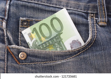 One hundred euro banknote in the jeans pocket.